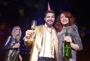 Happy couple with champagne celebrating new year