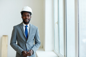 Happy foreman in helmet and suit
