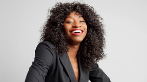 happy laughing businesswoman in studio shoot on light grey