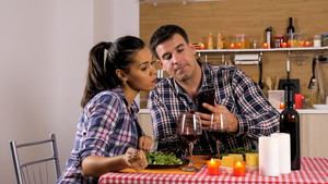 Happy loving couple is having romantic dinner at home. Happy couple