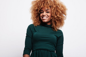 happy smiling african american black woman with blonde hair