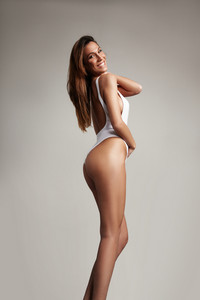 happy smiling spanish woman with ideal slin in swimsuit