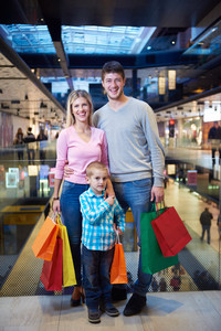 happy  young family with shopping bags in mall