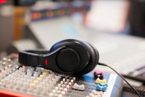 Headphones on Sound Mixer In Professional Radio Studio