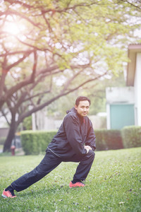 healthy asian man morning exercise in green home garden