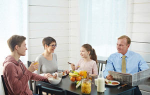 Healthy family of four having eco food for breakfast