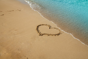 Heart inscripted on the beach sand