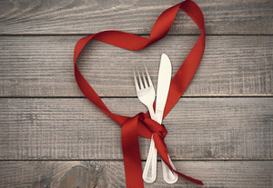 Heart shape ribbon and kitchen silverware