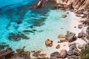 Hidden empty beach with pure clear turquoise sea water near white rock cliffs located in famous beach of Platys and Makrys gialos, Argostoli, Cefalonia island, Ionian, Greece