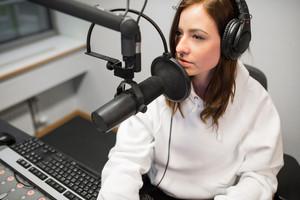 High Angle View Of Radio Jockey Communicating On Microphone