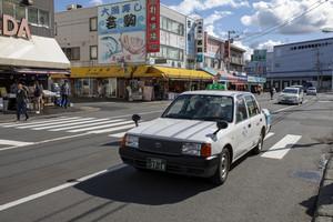 hokkaido japan - october8,2018 : old toyota taxi driving on Soen-Hassamu Dori road jogai seafood market hokkaido japan