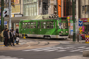 hokkaido japan - octobor 8,2018 :  old model of supporo city street car ,tram running on track ,sappora is principle city in hokkaido island northern of japan