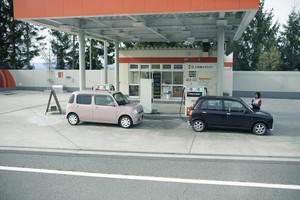 hokkaido japan - octobor5,2018 : two mini citycar refuel in eneos gas service hokkaido japan