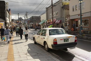 hokkaido japan - octobor7,2018 : old taxi car parking beside otaru town street ,otaru is one of most popular traveling destination sapporo hokkaido province japan
