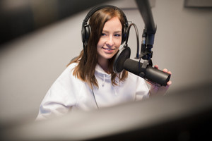 Host Using Headphones And Microphone While Looking Away
