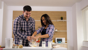Husband and wife cooking something delicious. Cool couple