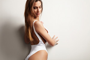ideal fit spanish woman watching down in studio shoot