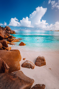 Idyllic scenery sea cloudscape of Grand Anse beach in La Digue island, Seychelles. Nature background