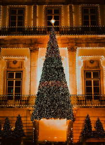 Illuminated Christmas tree against building in portuguese style , in Lisbon Portugal