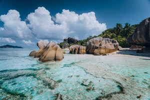Impressive cloudscape above Anse Source D'Argent tropical beach, La Digue Seychelles. Luxury exotic travel concept