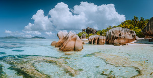 Impressive cloudscape at beautiful Anse Source d'Argent beach, La Digue Island, Seychelles. Spectacular location
