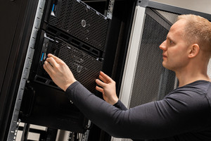 IT Professional Working With Servers In Large Datacenter
