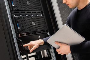 IT Support Holding Digital Tablet Examining and Perform Service on Servers