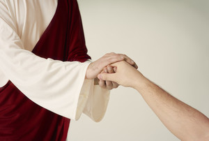 Jesus hand rescue and reaching humans one