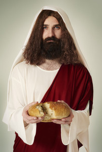 Jesus sharing the bread into pieces
