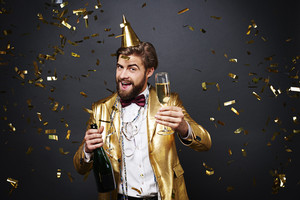 Joyful man drinking a champagne