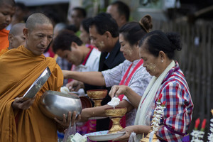 kanchanaburi thailand : february25,2019 : thai villager in sangkhla buri district western territory of thailand offering food to buddhist monk at early morning
