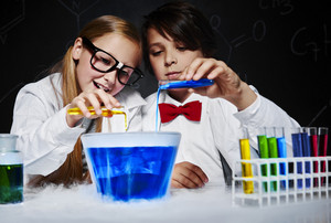 Kids making a serious experiment