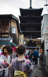 kyoto japan - november10,2018 : woman wearing kimono japanese tradition clothes attraction to yasaka shrine street one of most popular traveling destination in kyoto japan