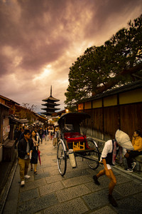 kyoto japan - november9,2018 : japanese man pulling rickshaw on yasaka street,yasaka shrine one of most popular traveling destination in kyoto