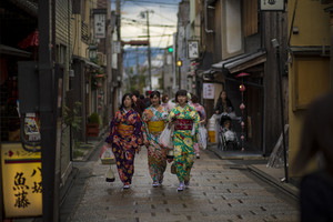 kyoto japan - november9,2018 : japanese woman wearing kimono clothes walking in yasaka shrine street most popular traveling destination in kyoto japan