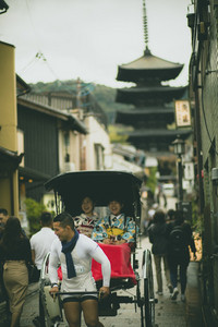 kyoto japan - november9,2018 : japanese woman wearing kimono old traditon clothes sitting in rickshaw on yasaka street,yasaka shrine one of most popular traveling destination in kyoto
