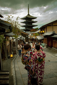 kyoto japan - november9,2018 : japanese woman wearing kimono old traditon clothes taking photograph at yasaka shrine street, yasaka shine pagoda is one of most popular traveling destination in kyoto japan