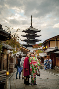 kyoto japan-november9,2018:japanese woman wearing kimono old traditon clothes taking photograph at yasaka shrine street, yasaka shine pagoda is one of most popular traveling destination in kyoto