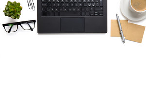 Laptop With Eyeglasses, Coffee Cup And Adhesive Notes On Isolated White