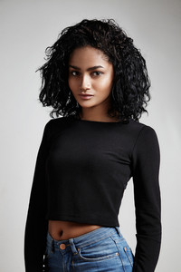 latin woman wear jeans and black top
