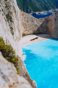 Limestone chalk colored like huge cliff rocks surrounding Navagio beach with Shipwreck and azure blue sea water. Zakynthos island, Greece