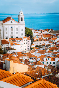 Lisbon, Alfama district with orange roof tiles and white walls, Portugal