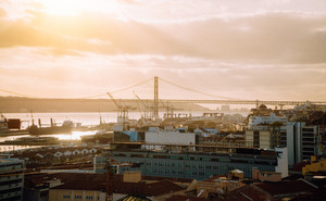 Lisbon panoramic view. Tagus river, the bridge and the shipyard at sunsetlight. Portugal