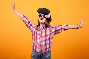 Little girl having fun while she has her VR on. Studio photoshoot