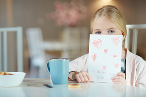 Little girl with self-made greeting card