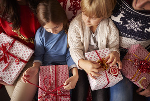 Little kids are ready for opening Christmas presents