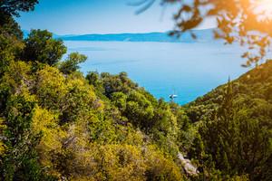 Lonely yacht between hills on hidden Fteri beach lagoon, Kefalonia, Greece