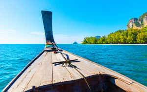 Longtail Boat At Aonang Beach Against Blue Sky