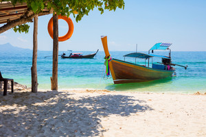 Longtail Boat Moored At Beach On Sunny Day