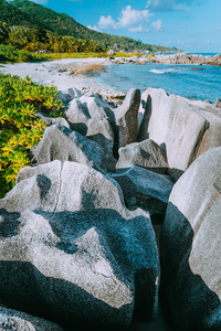 Lovely tropical beach with unique granite formations in south-west of La Digue island, Anse aux Cedres, Seychelles